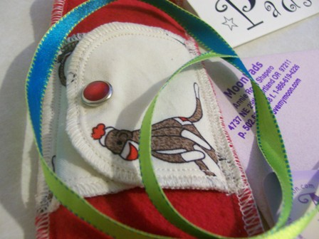 Arty farty shot of my (then new) sock money pad, from Moon Pads. (The sock monkey part is one of the wings.)
